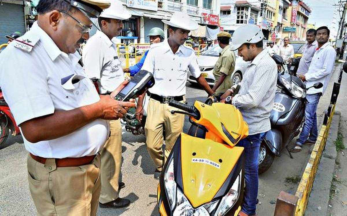 New rules Cap less fines Traffic police strike fear in 2 wheeler riders